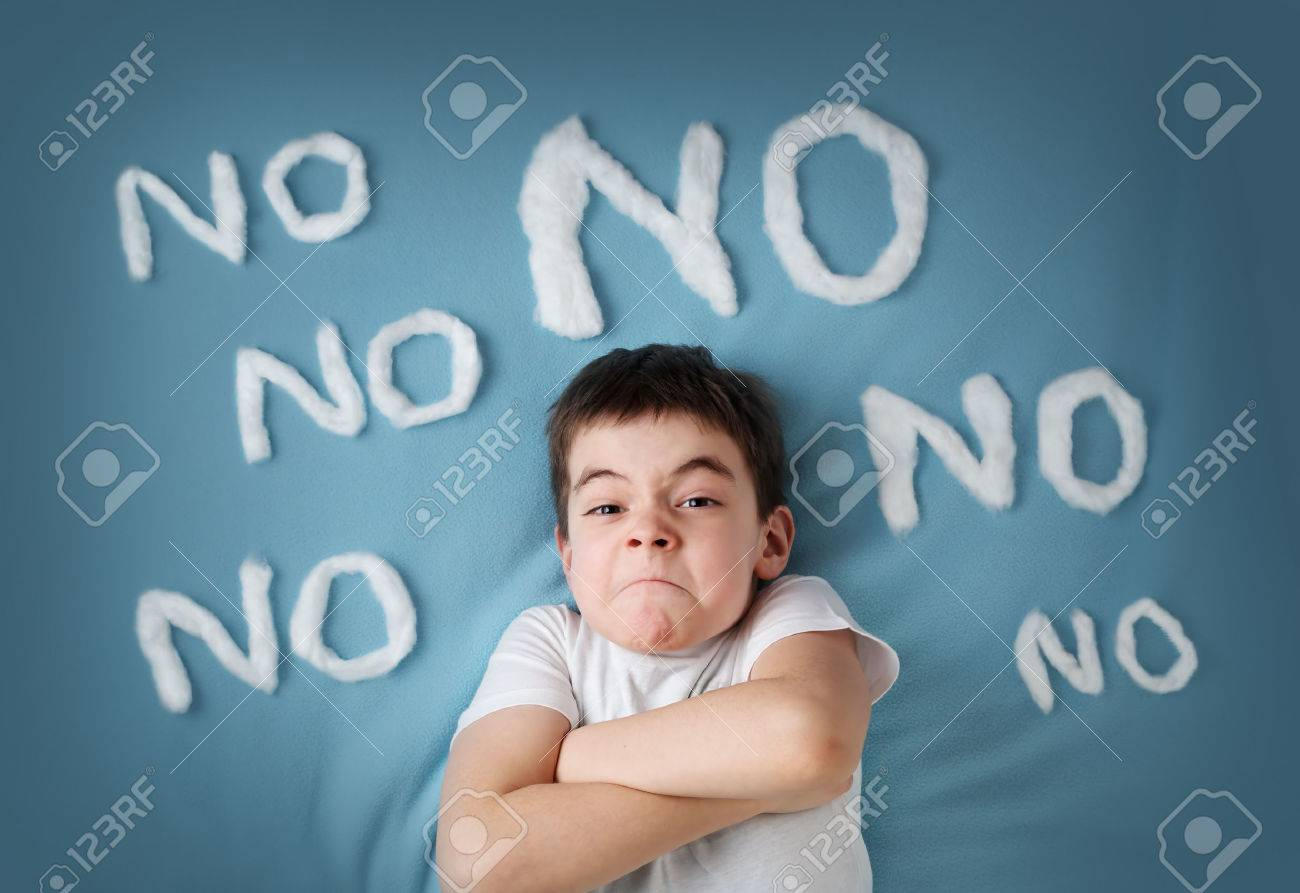 bad boy on blue blanket background. Angry child with no words around - 52382220