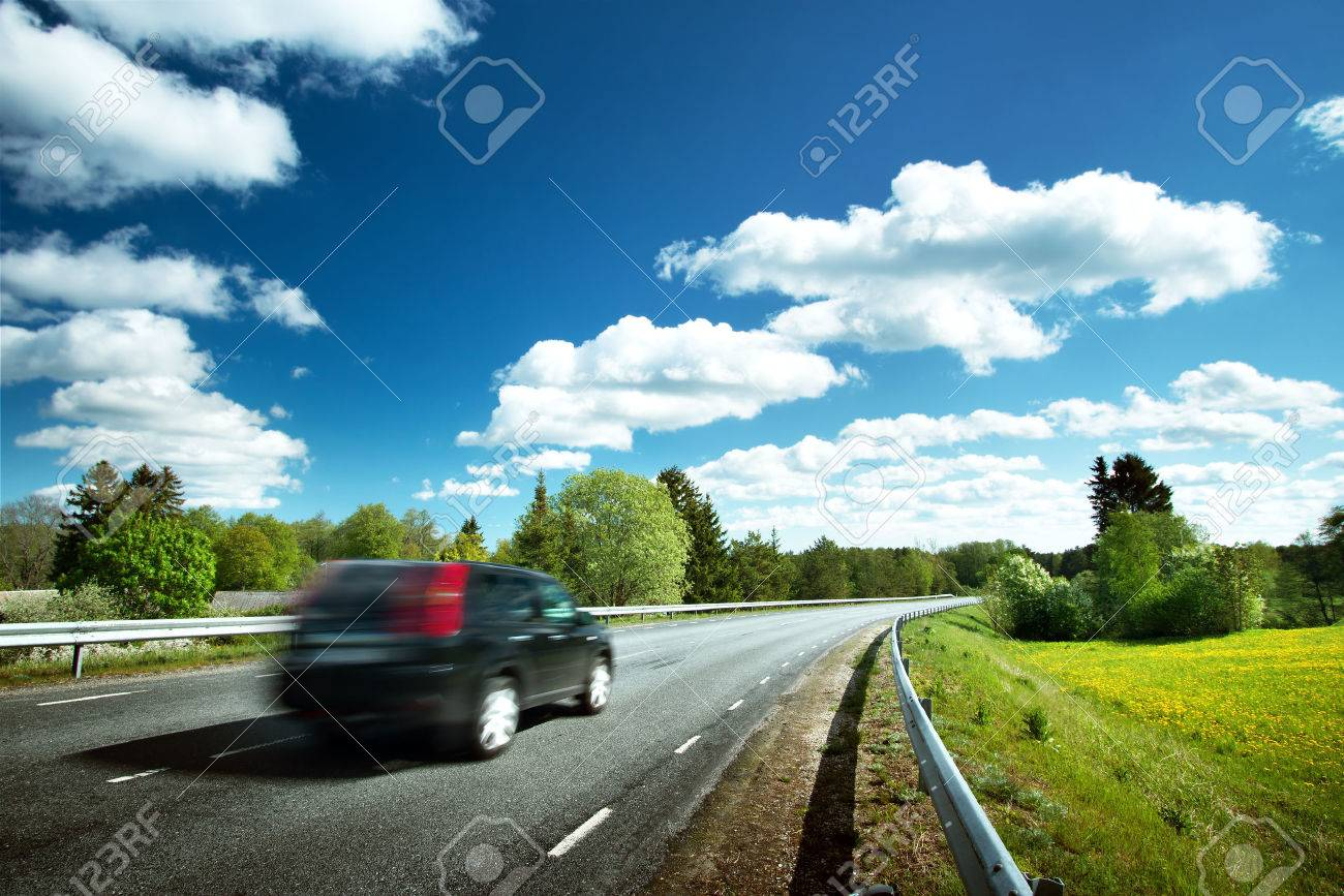 Car on asphalt road in beautiful spring day at countryside - 59043473