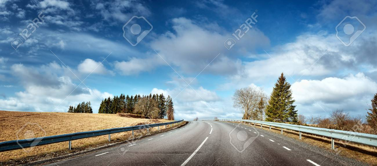 black asphalt road on sunny spring da - 71129468