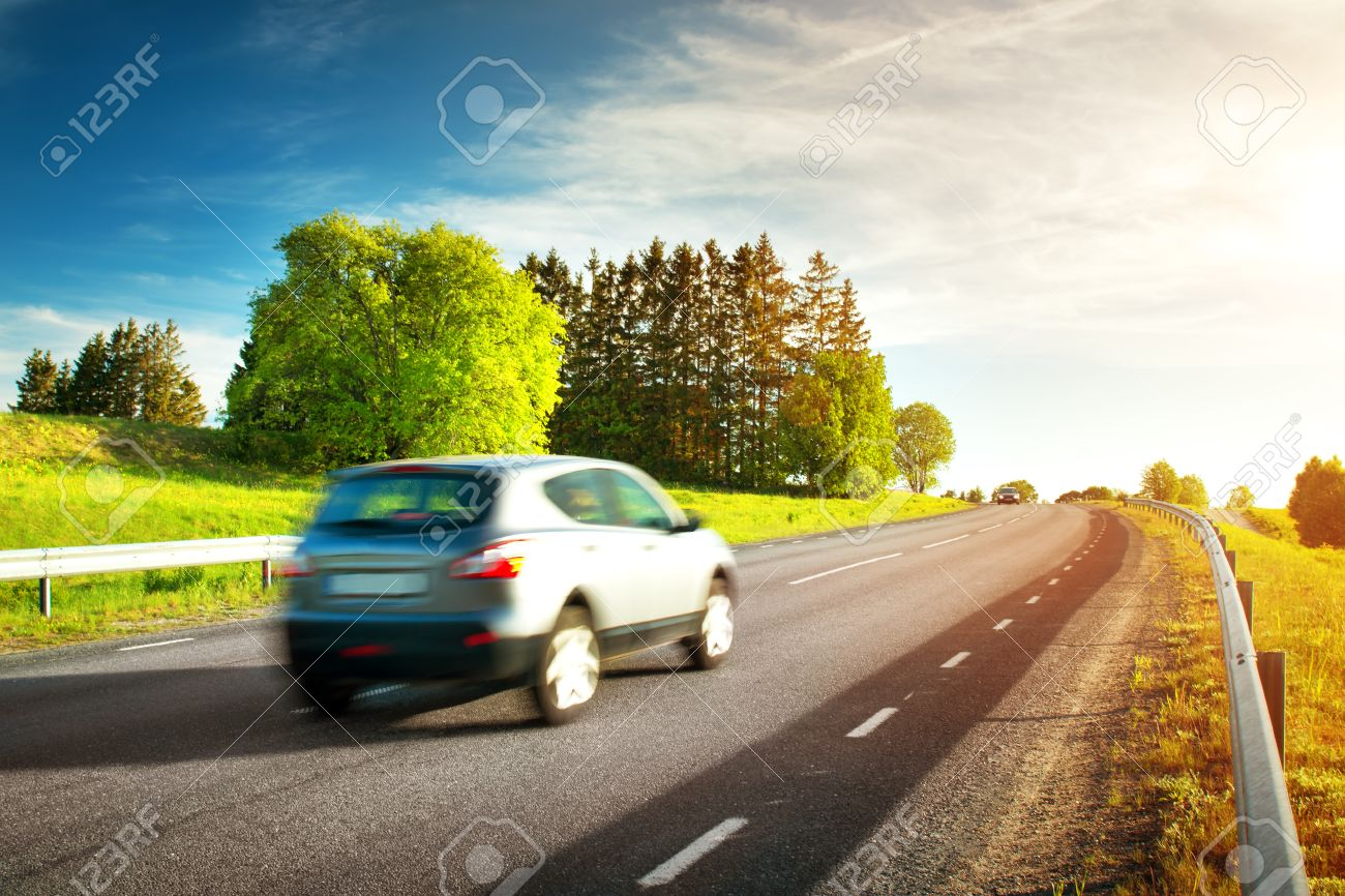 car moving on sunny evening - 73265132
