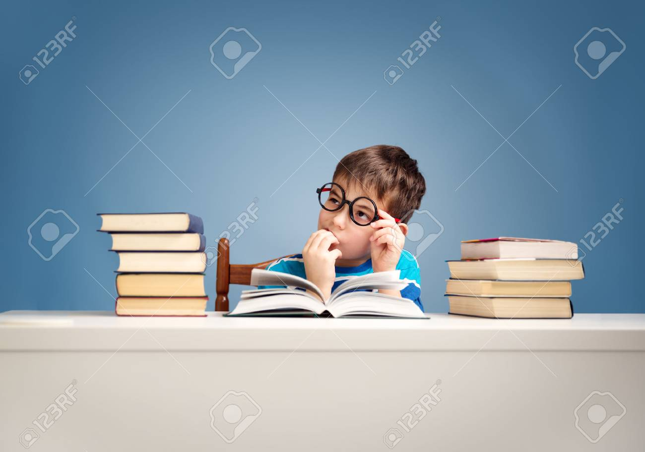 seven years old child reading a book - 78002398