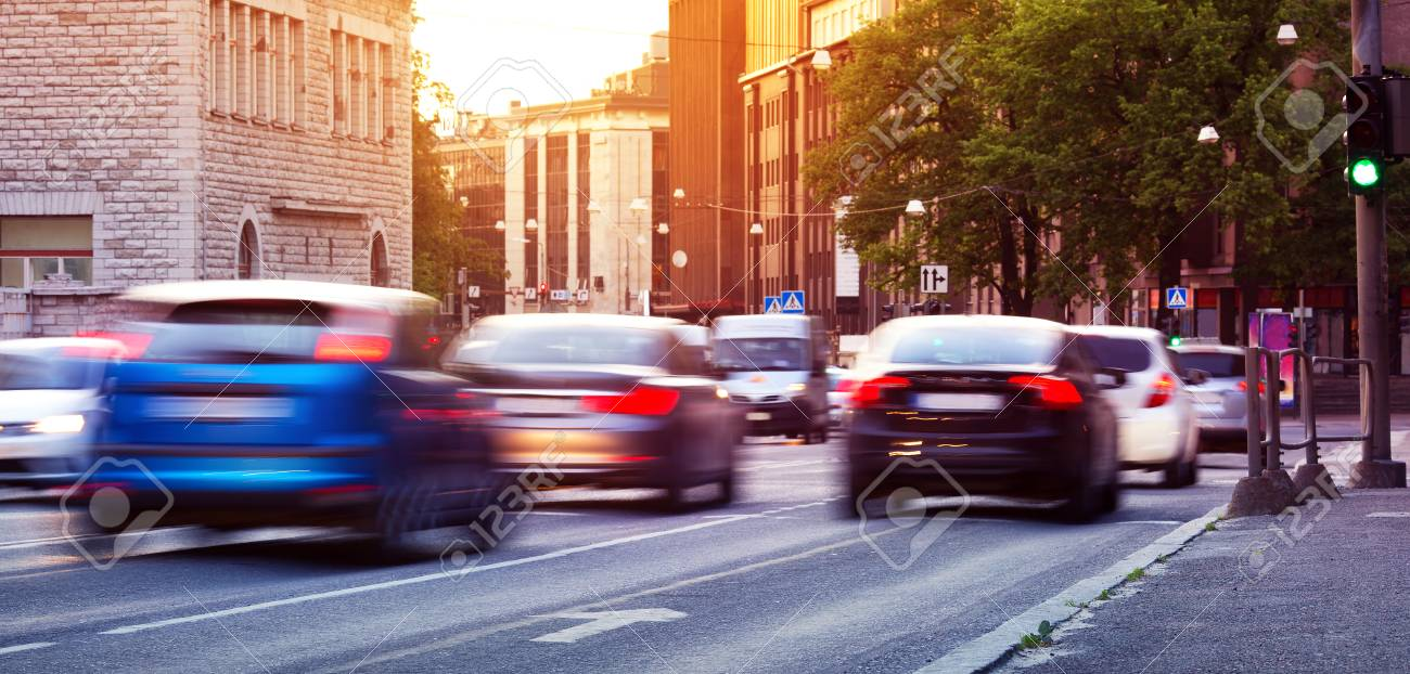 Cars moving on the urban road at dusk - 81183059