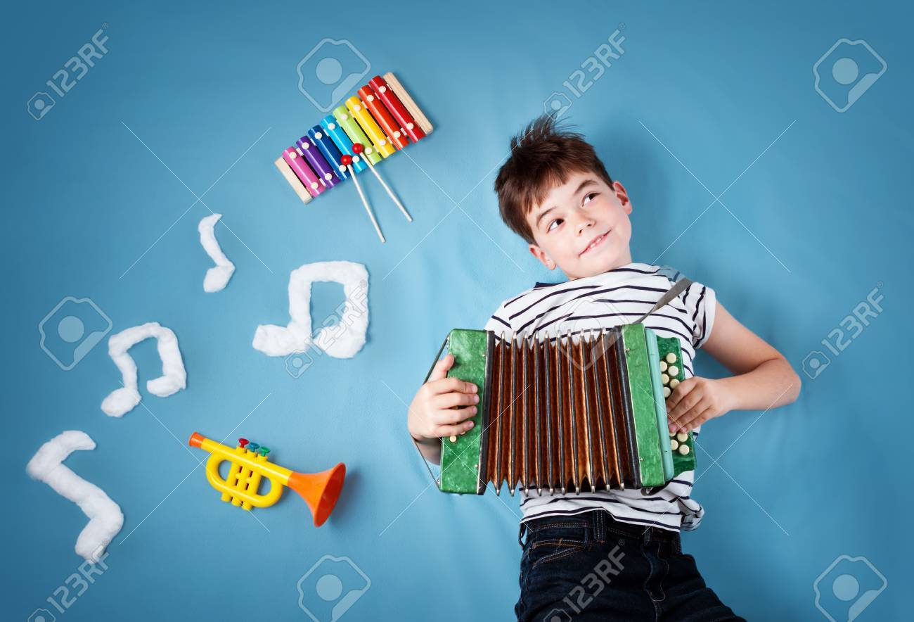 boy on blue blanket background with accordion - 81446735