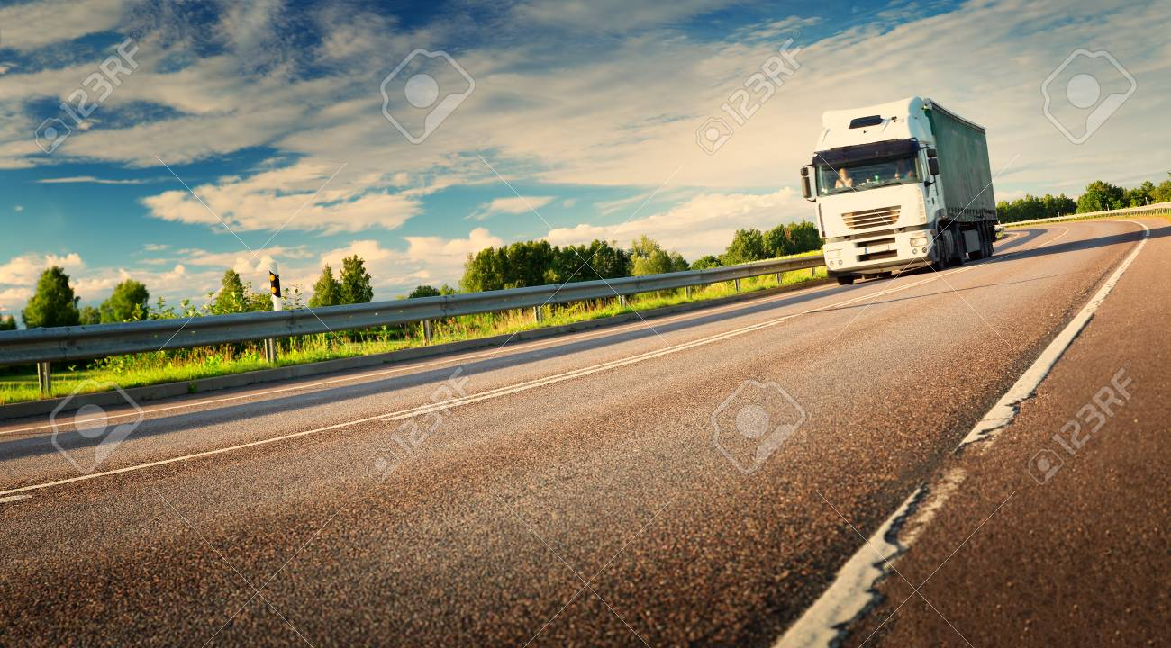 lorry moving on sunny evening - 83859955