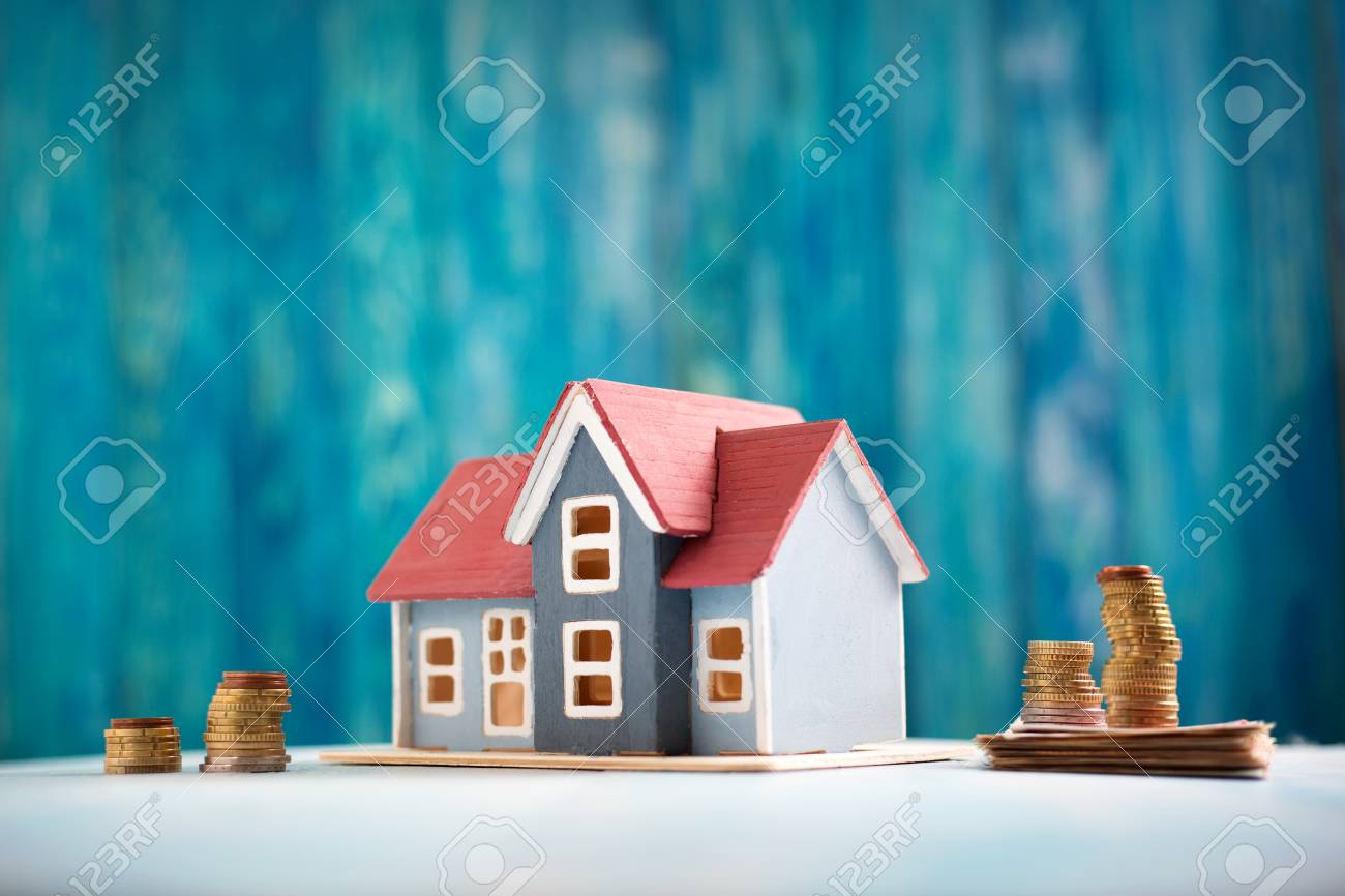 Red house on wooden background with banknotes - 94734061
