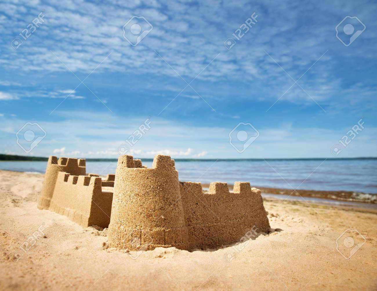 Sandcastle on the sea in summertime - 97186582
