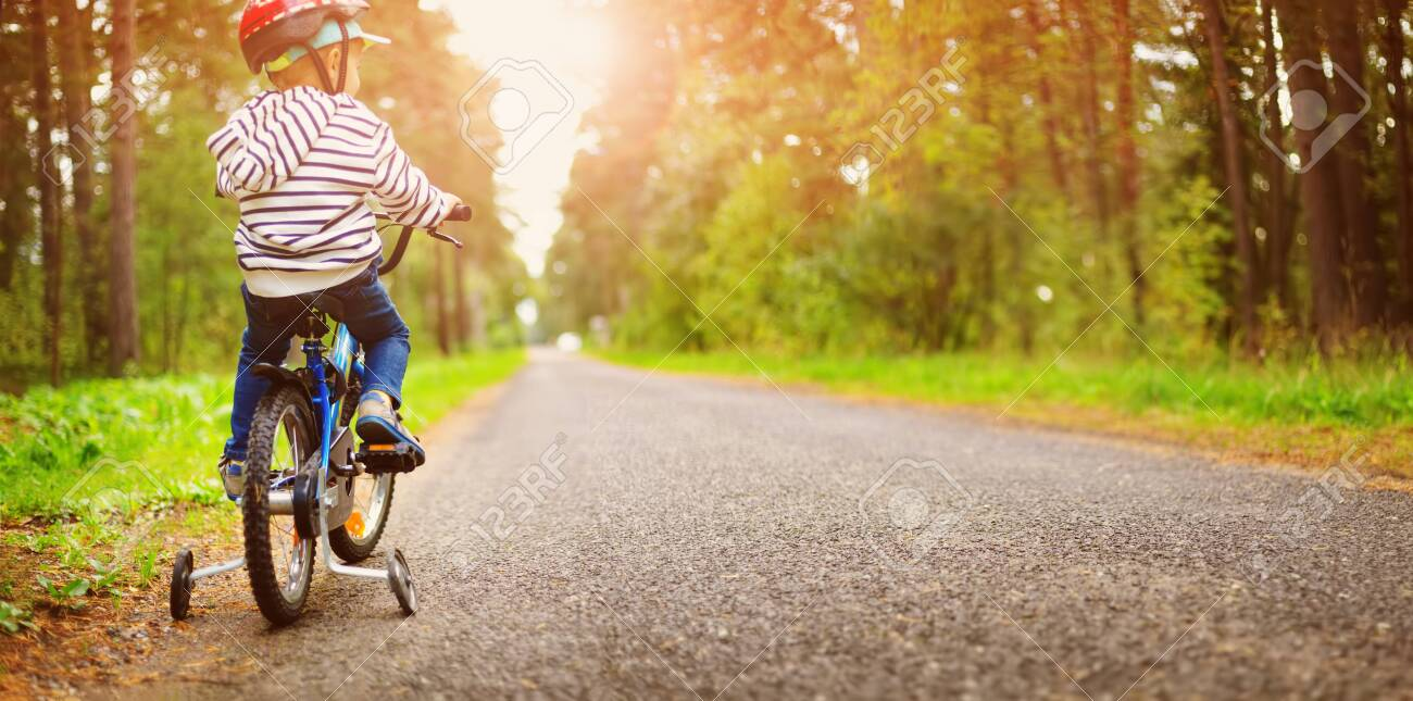 a child on a bicycle in helmet - 131649348