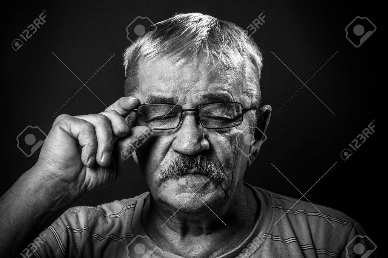 393954575851 portrait of an old man in glasses with eyes closed Stock Photo - 37162954