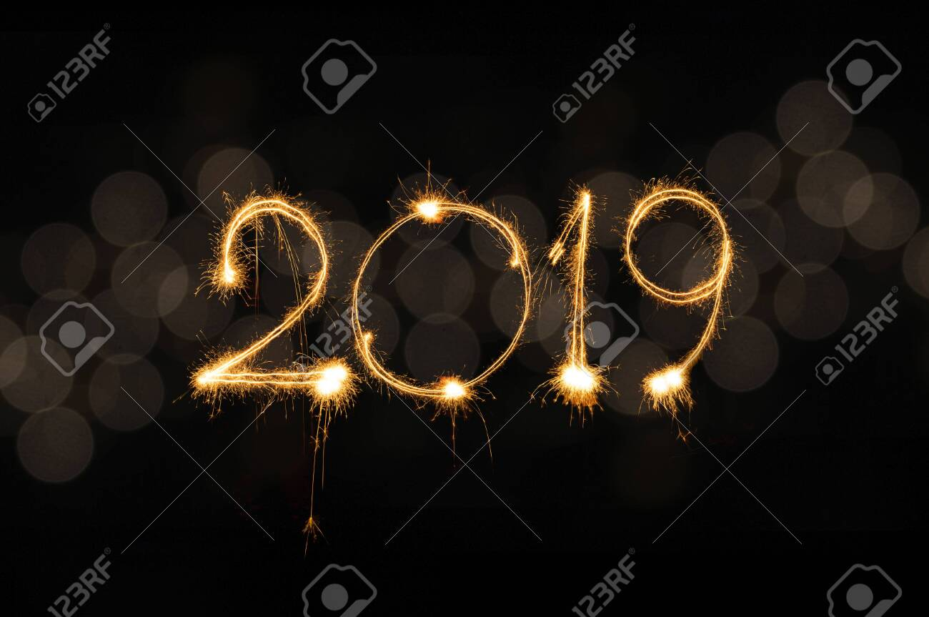 Happy new year 2019 text written with Sparkle fireworks isolated on black background - 124002127