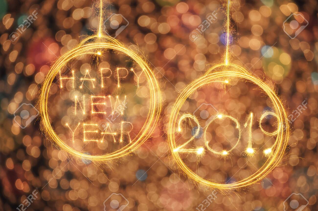 Hang Happy new year text in ball and 2019 written with sparkle fireworks on gold bokeh background - 124002319