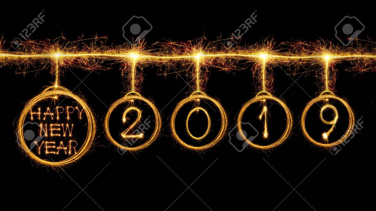 Happy new year 2019 text and circle look like bulb written with sparkle fireworks isolated on black background - 124002341