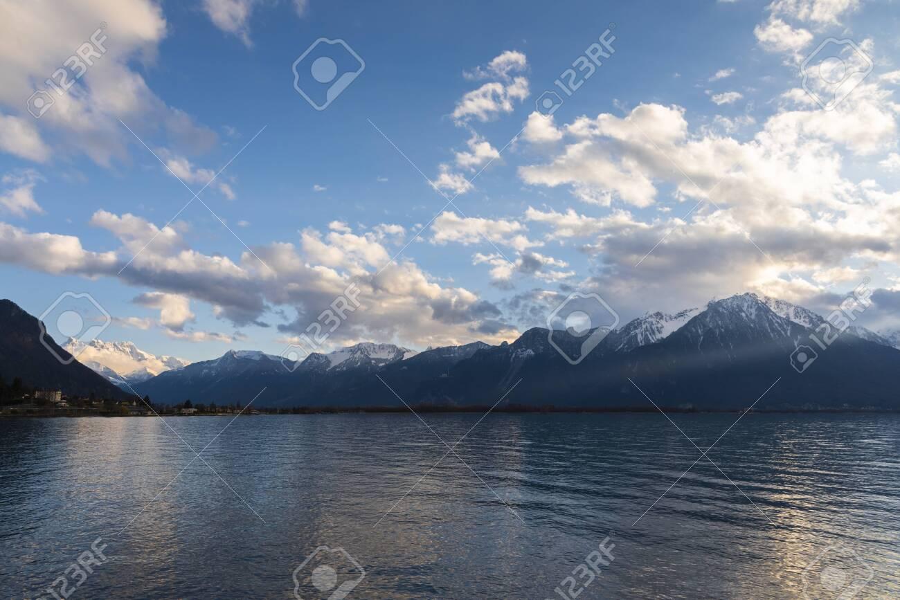 Beautiful sunset and snow mountains at Lake Geneva, Montreux, Switzerland - 124002342