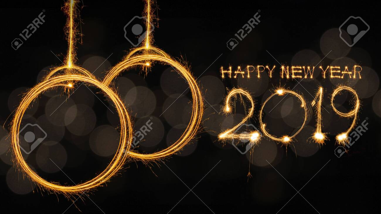 Happy new year 2019 text written with Sparkle fireworks isolated on black background - 124002206