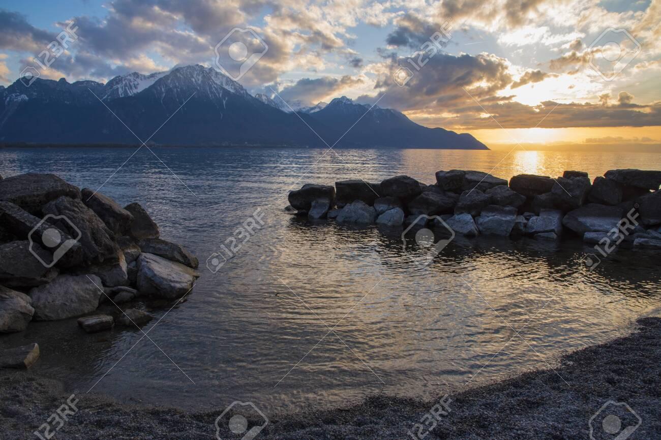 Beautiful sunset and snow mountains at Lake Geneva, Montreux, Switzerland - 124002207