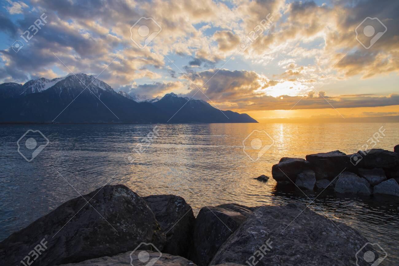 Beautiful sunset and snow mountains at Lake Geneva, Montreux, Switzerland - 124002212