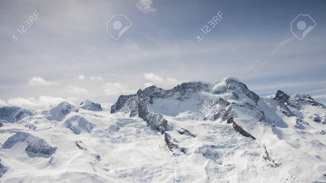 The famous alps mountain peak with cloudy and blue sky from Gornergrat, Zermatt, Switzerland - 131649269