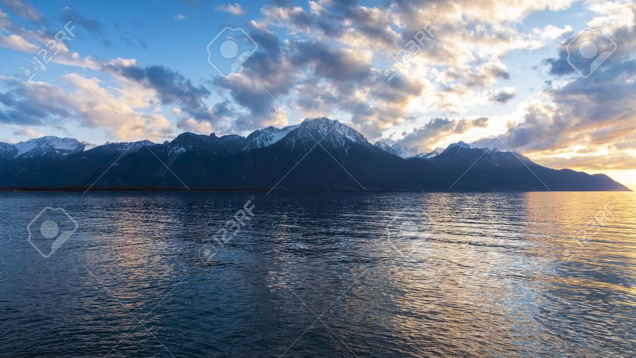 Beautiful sunset and snow mountains at Lake Geneva, Montreux, Switzerland - 131649035