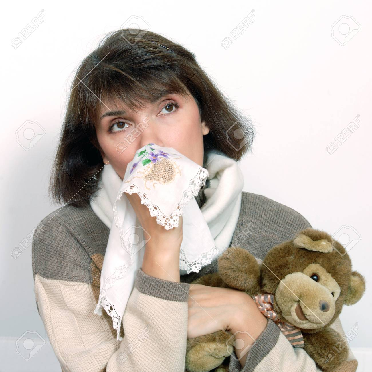Affected by cold woman with a handkerchief and a teddy bear stock affected by cold woman with a handkerchief and a teddy bear stock photo 68980901 altavistaventures Choice Image