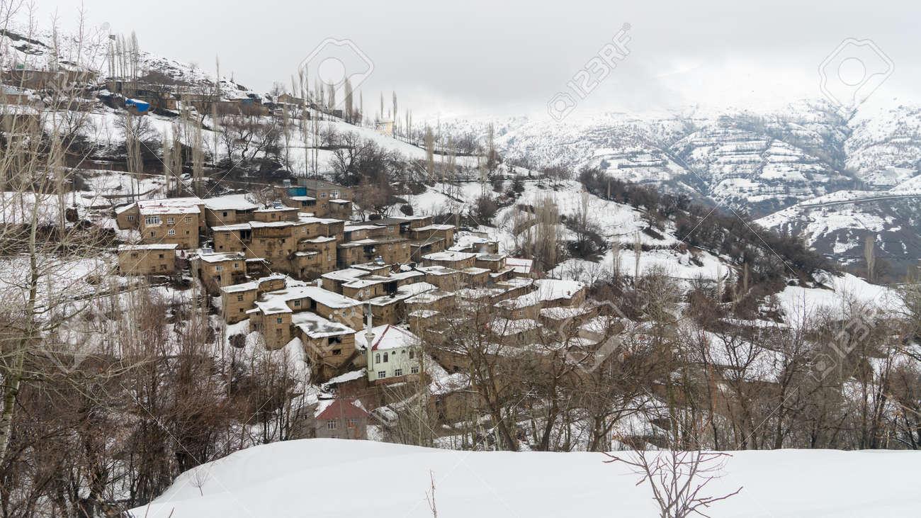 Hizan, Bitlis, Turkey - February 2020: Remote village in Eastern Turkey Anatolia with stone houses, snowy landscape, Hizan, Bitlis, Turkey - 164356072