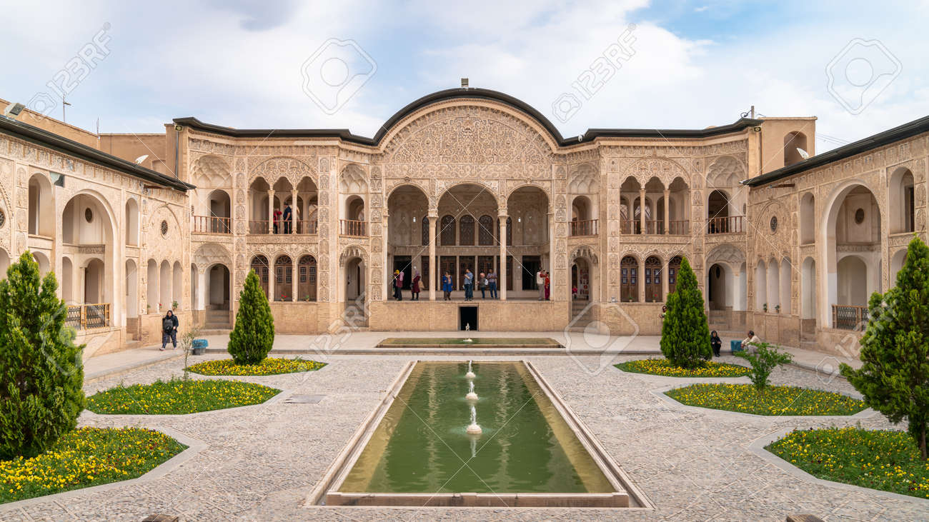 Kashan, Iran - May 2019: Tourists visiting Tabatabaei Natanzi Khaneh Historical House. Wonderful Persian architecture. Kashan is a popular tourist destination of the Middle East. - 164356044