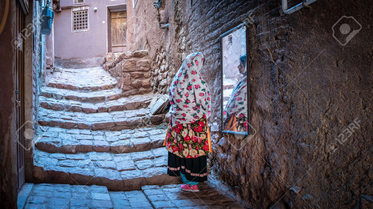 Abyaneh, Iran - May 2019: Unidentified Iranian woman with traditional Abyaneh Persian dress - 164356042