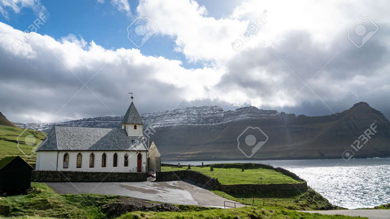Vidareidi, Faroe Islands - August 2019: Vidareidi village with village's church, Vidoy island, Faroe Islands, Denmark. - 164356036