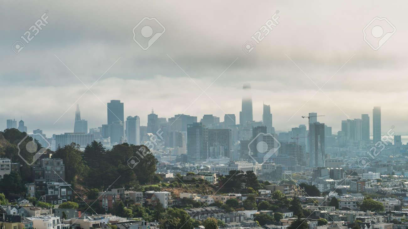 San Francisco, California, USA - August 2019: San Francisco downtown cityscape on a hazy day - 164356023