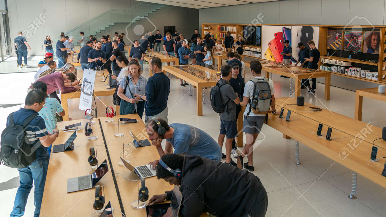 San Francisco, California, USA - August 2019: People examining Apple products laptops phones and tablets at Apple Store in Union Square - 164356010