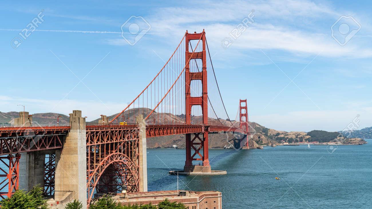 San Francisco, USA - August 2019: Golden Gate Bridge on a sunny summer day. The Golden Gate Bridge is a suspension bridge spanning the Golden Gate. - 164356006