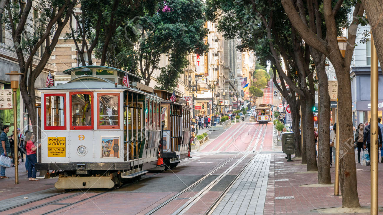 San Francisco, California, USA - August 2019: People riding the cable car in San Francisco. It is the oldest mechanical public transport in California. - 164355970