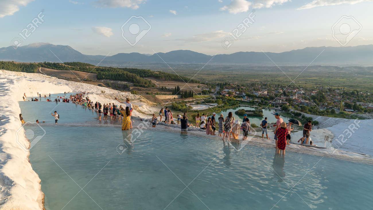 Pamukkale, Turkey - October 2019: Tourists on Pamukkale Travertine pools and terraces. Pamukkale is famous UNESCO world heritage site in Turkey - 164355965