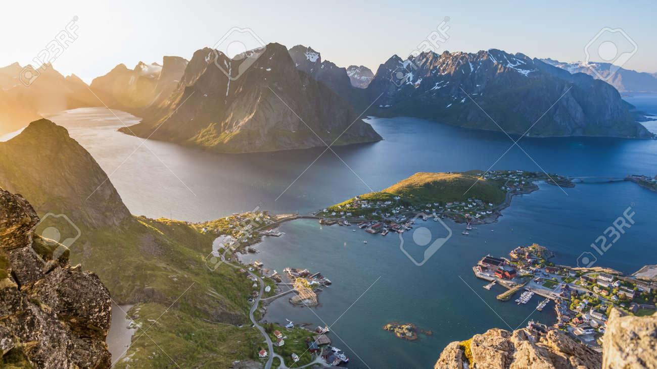 Reinebringen, view on stunning mountains of Lofoten islands overlooking Reine, a famous fishing village in northern Norway, Scandinavia. - 164386213