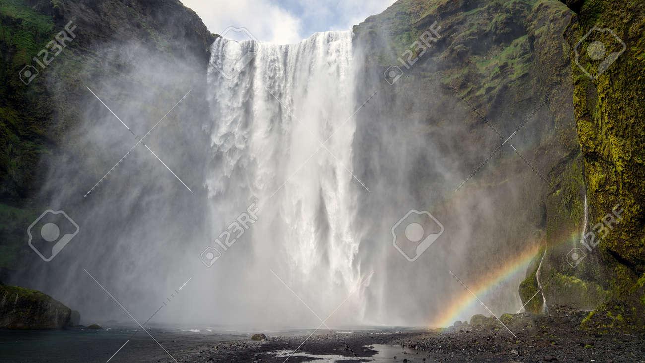 Huge waterfall of Skogafoss with a rainbow, Skogar, south of Iceland - 164386264