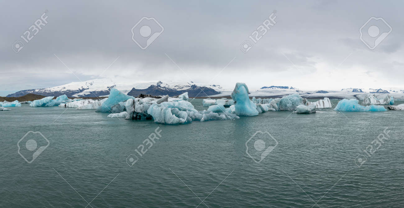 View of icebergs in Jokulsarlon glacier lagoon formed with melting ice, Iceland, global warming and climate change concept - 164386323