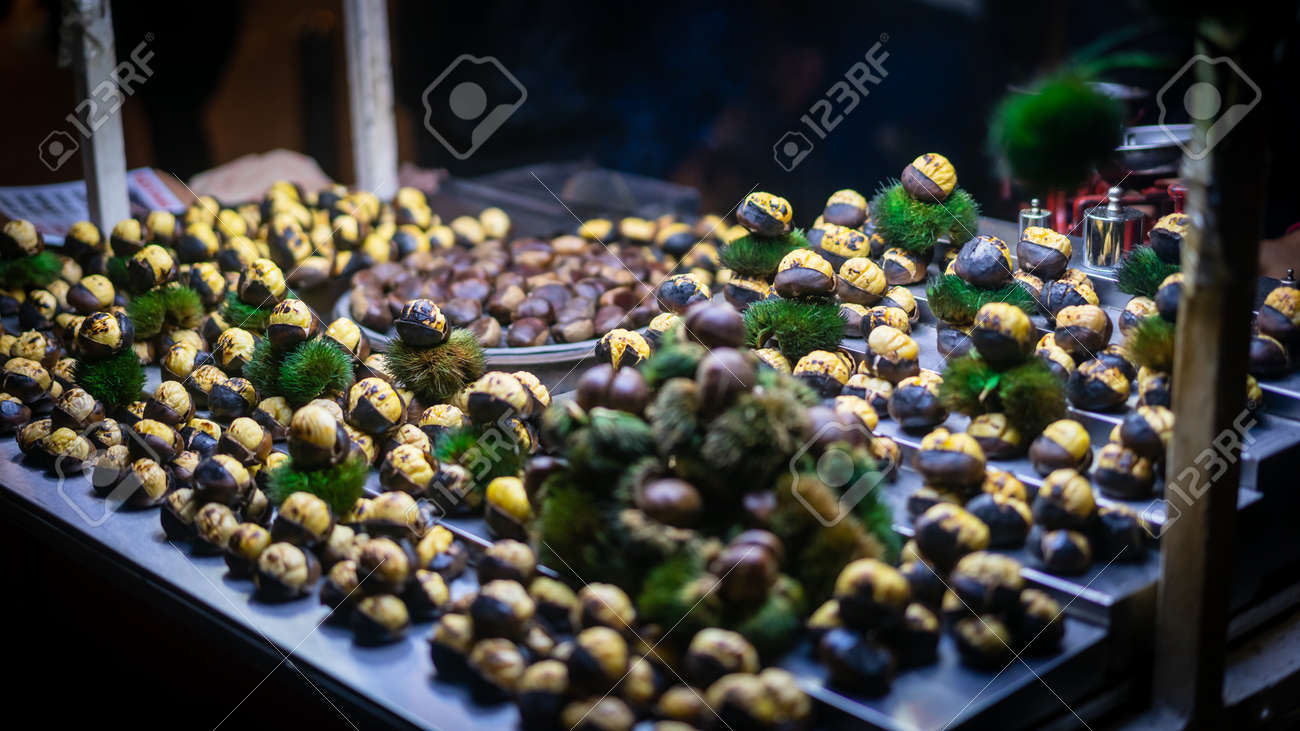Cart of roasted chestnut on the main pedestrian Taksim Istiklal Street at late evening. Depth of field and blurring done intentionally and originally - 164386369