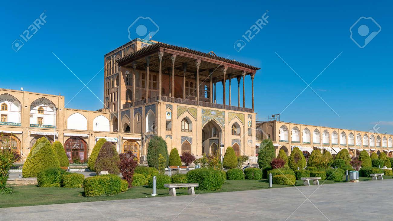 Isfahan, Iran - May 2019: Ali Qapu Palace is a grand palace in Isfahan on Naqsh-e Jahan Square - 169860198