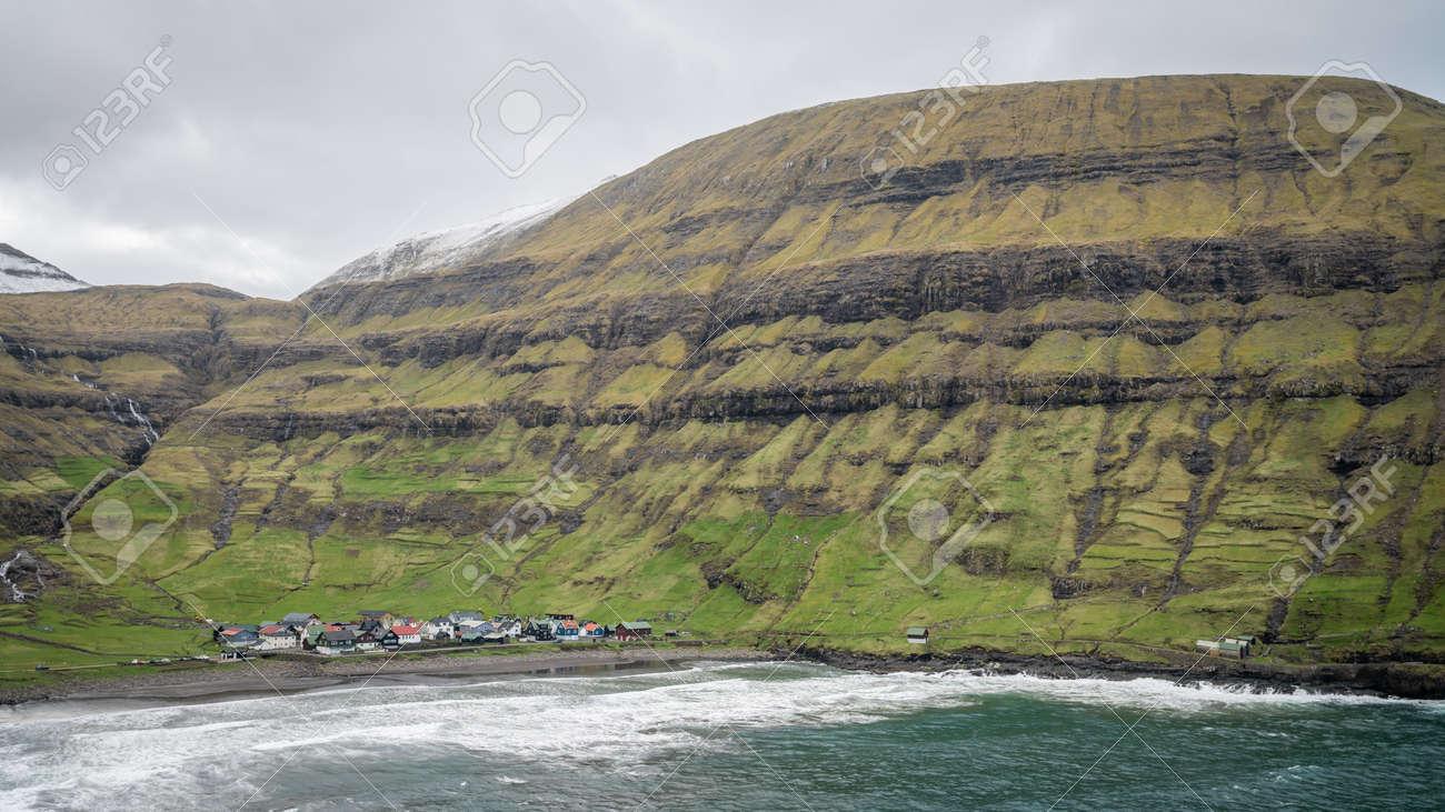 Village of Tjornuvik on Streymoy and dramatic mountain landscape on the Faroe Islands, Denmark, Europe - 170682393