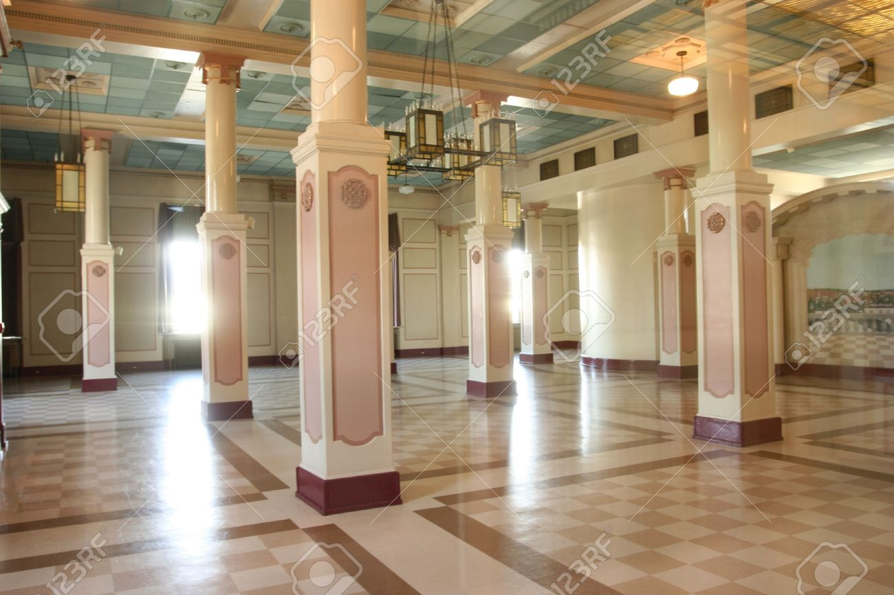 art deco building interior with pillars and light coming from