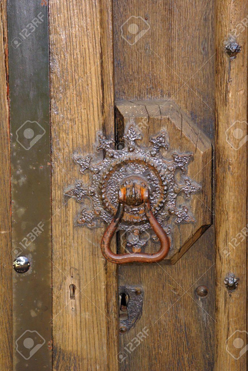 Medieval Ornate Brass Door Knob On A Wooden Door Stock Photo