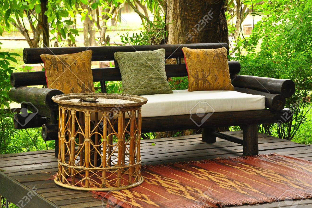Relaxing in a Thai styled living area, rural villa Stock Photo - 11652480