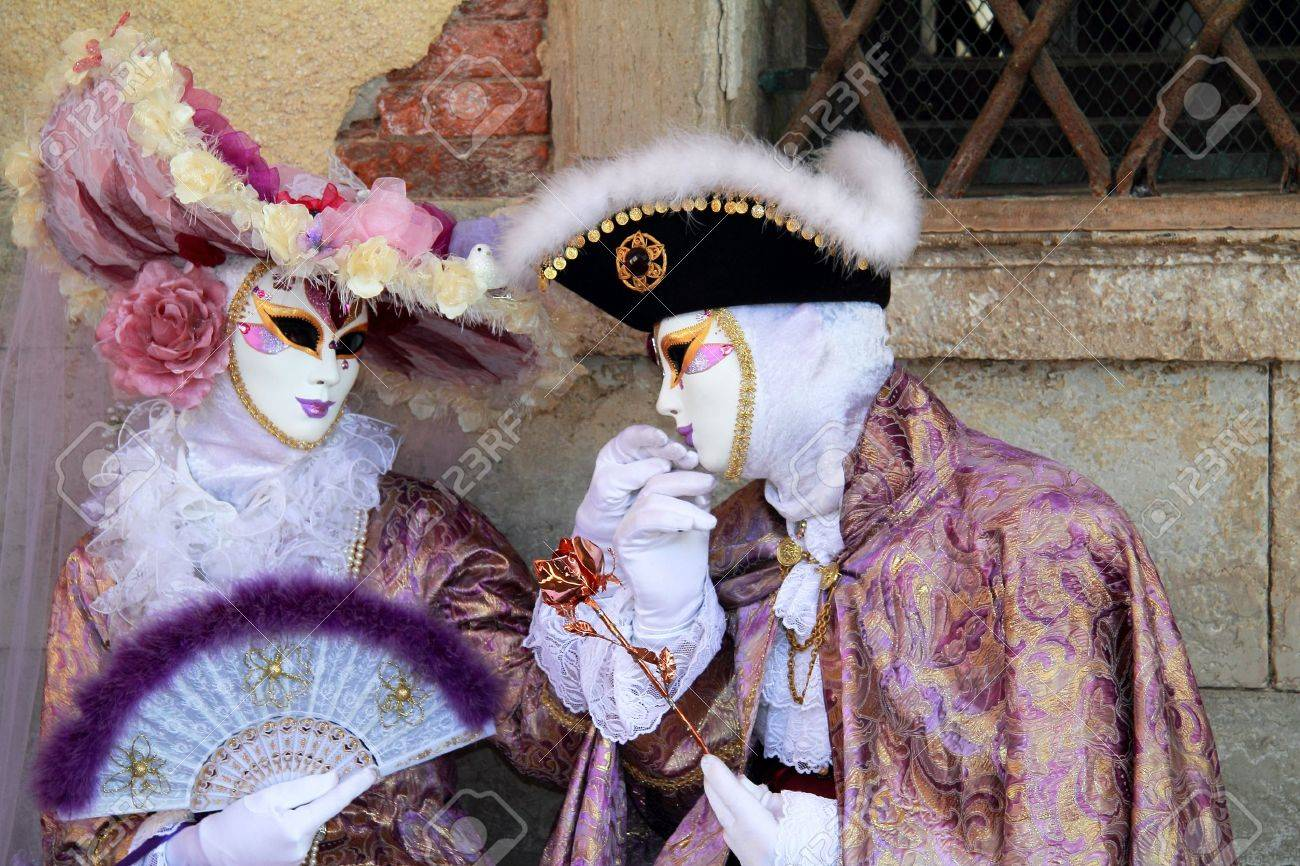 Elegant noble couple masked at Venice carnival 2012   Man is kissing lady Stock Photo - 12797783
