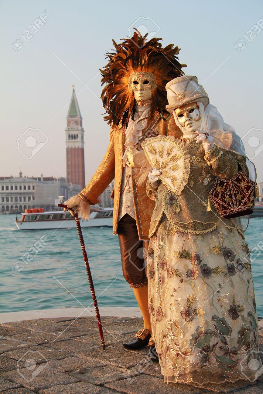 Elegant Couple Of Venetian Masks In Sunset Light With San Marco ...