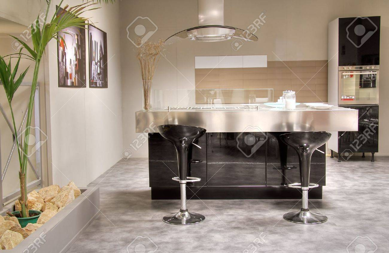 Modern kitchen with steel table and cooking platform. Stylish and elegant Stock Photo - 16523251