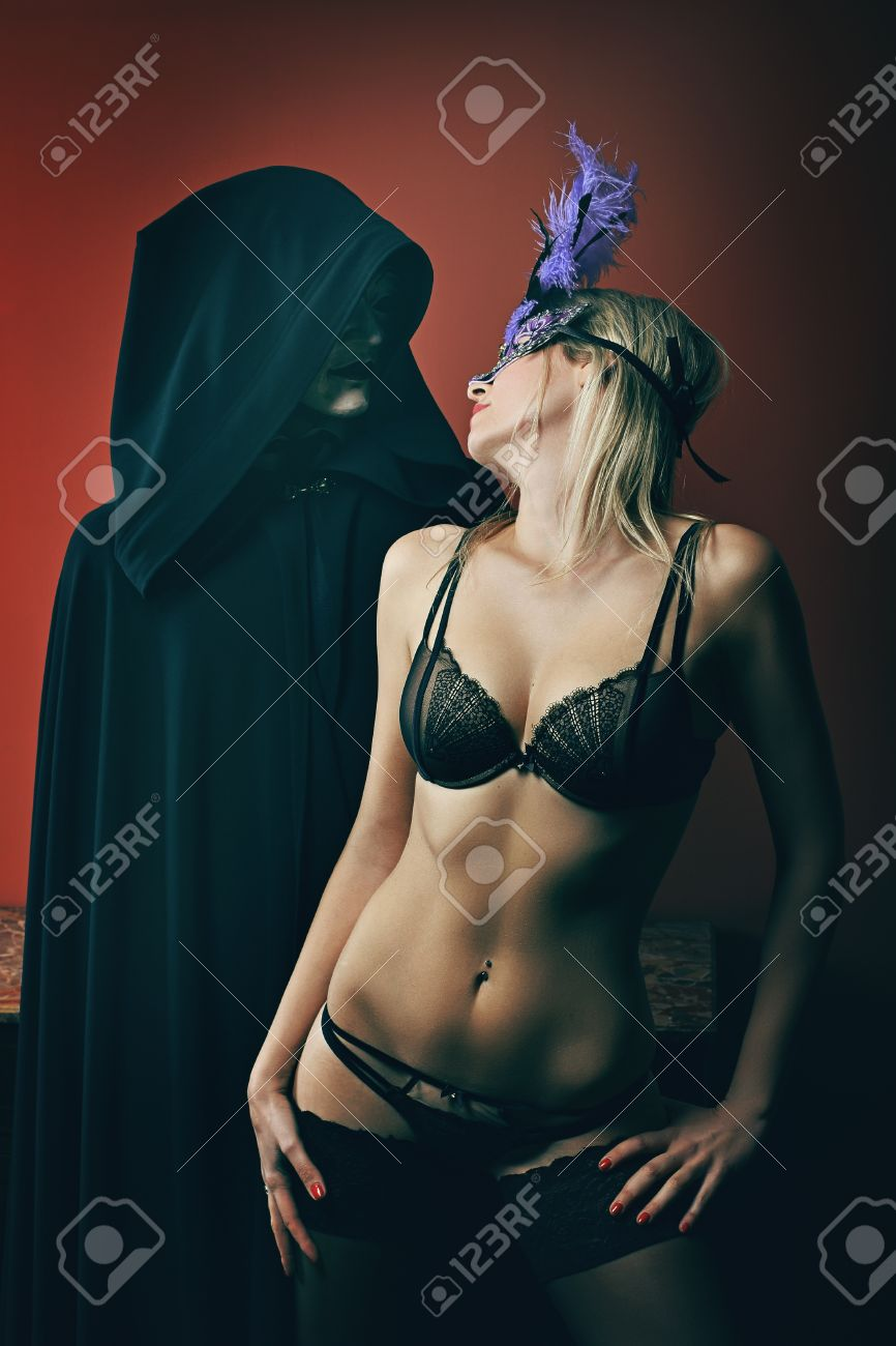 79f77bd166b35 Mysterious masked man and beautiful woman in lingerie . Venice masquerade  Stock Photo - 34931915