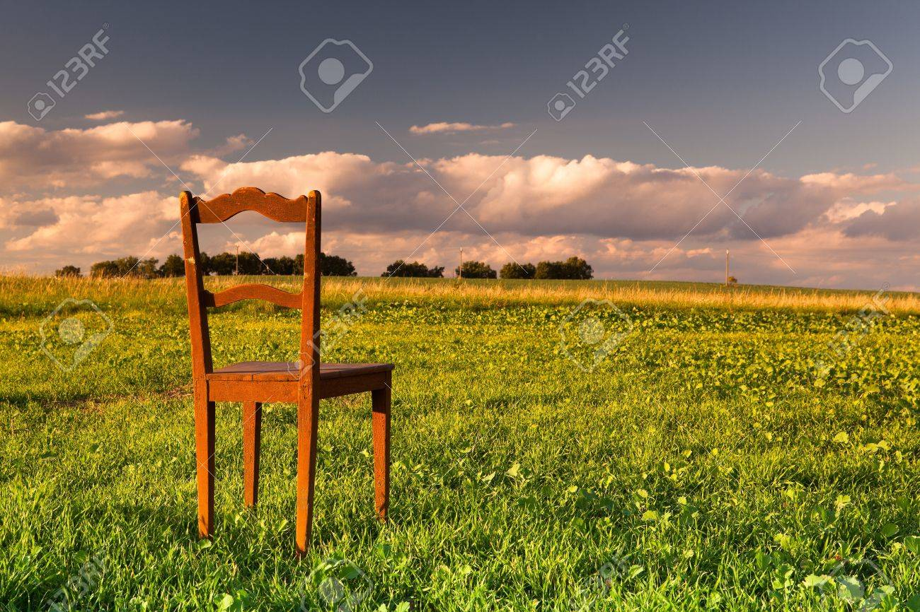 Stock Photo - The restless chair on the empty field at sunset & The Restless Chair On The Empty Field At Sunset Stock Photo Picture ...