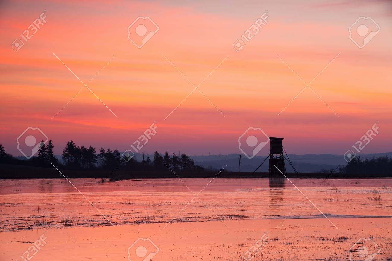 Hunters tower near the pond in winter at sunrise Stock Photo - 22070838