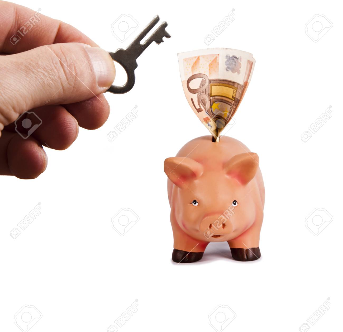 hand with key open the piggy bank for savings Stock Photo - 18877107