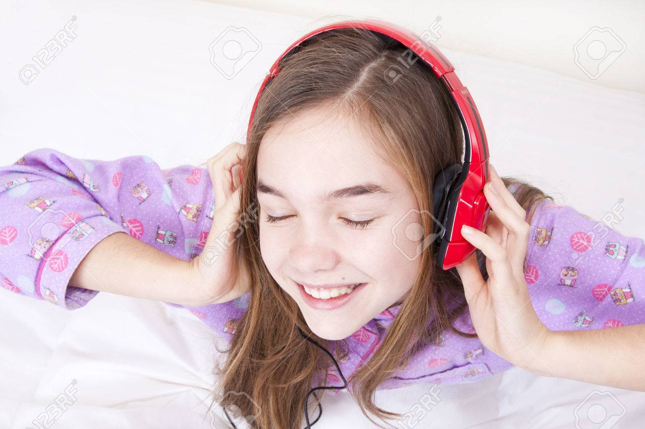 Happy smiling girl with headphones listening to music Stock Photo - 25060289