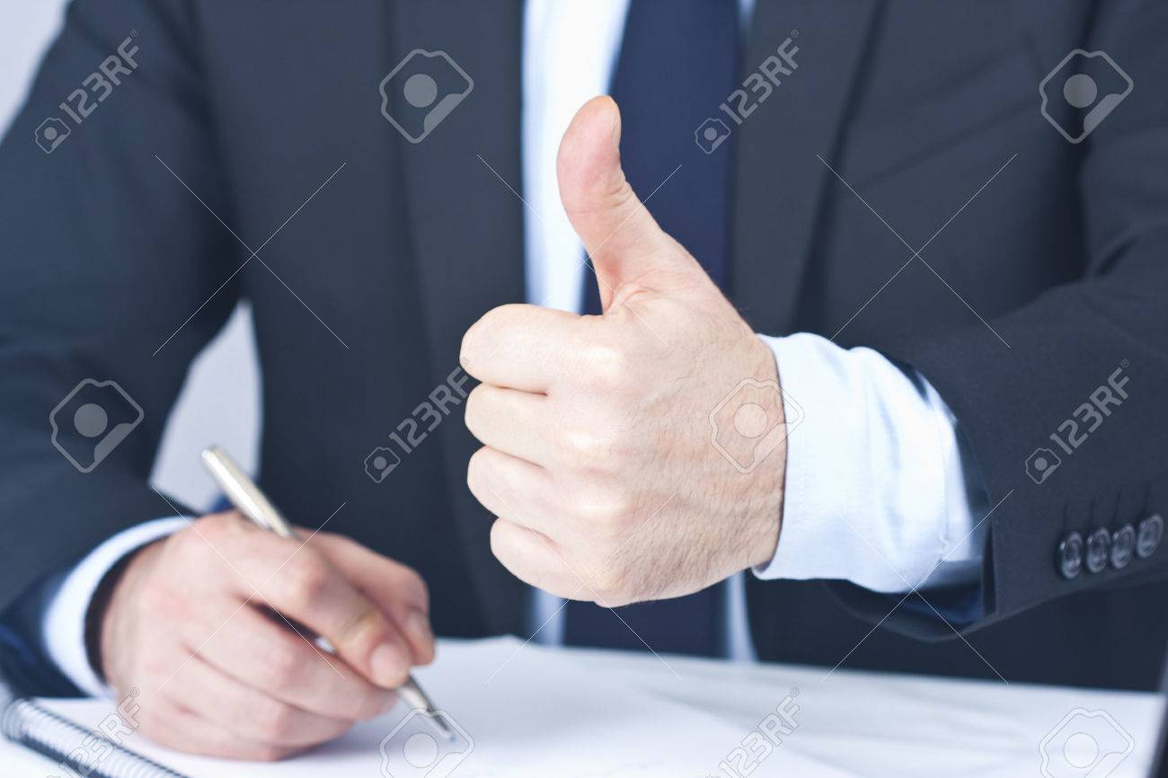Businessman with hand in approval and okay - 26080511
