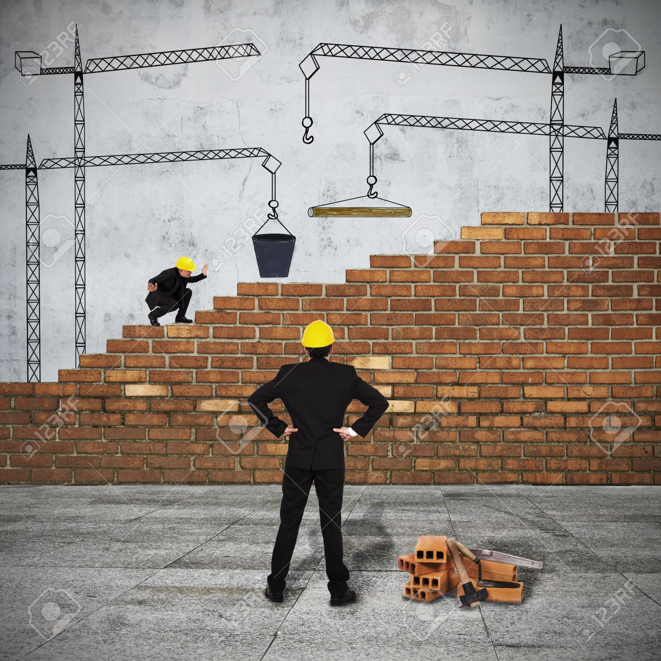 Business Group Of Men Building The Brick Wall Stock Photo